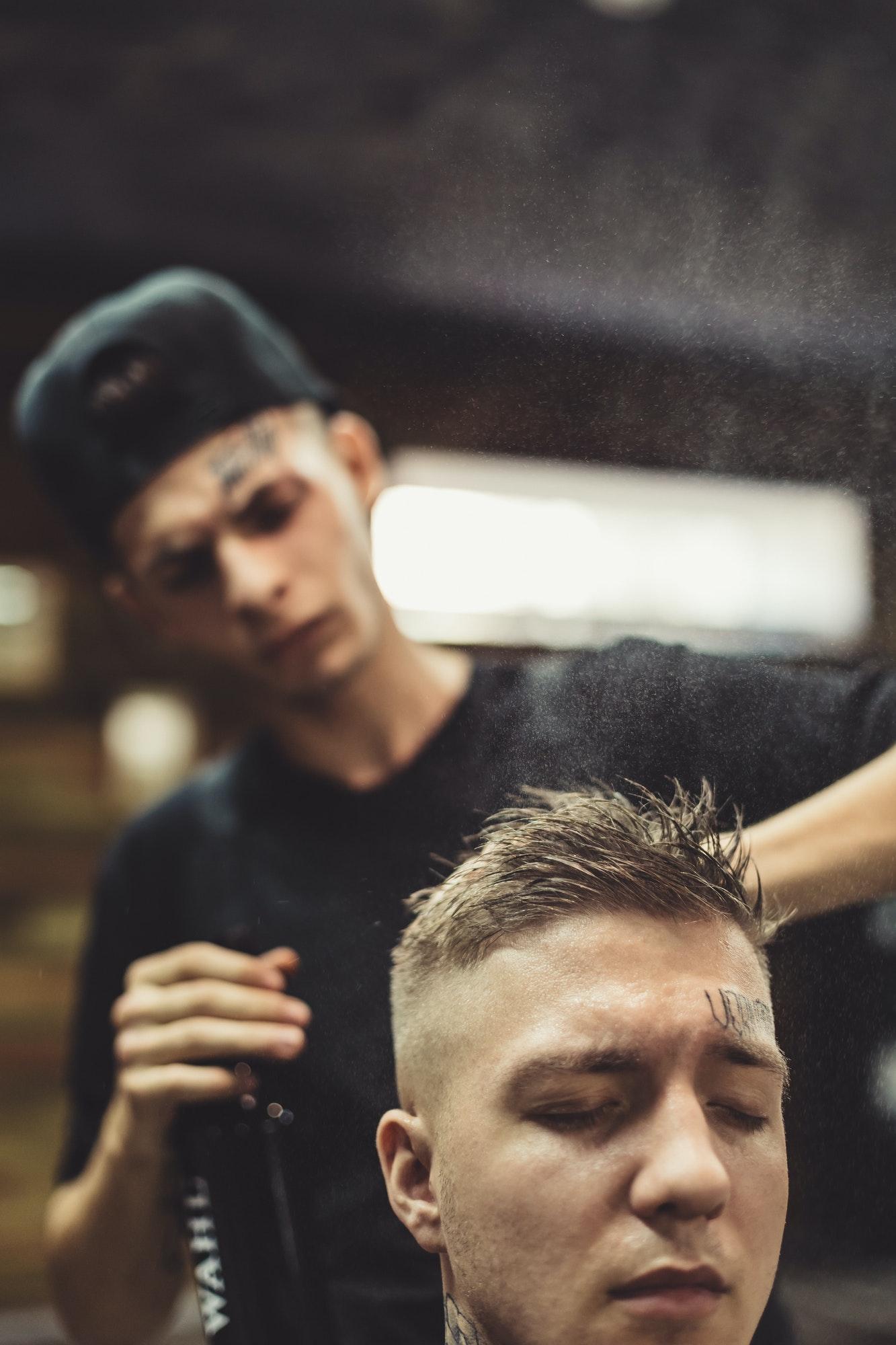 stylist-grooming-client-in-barbershop.jpg
