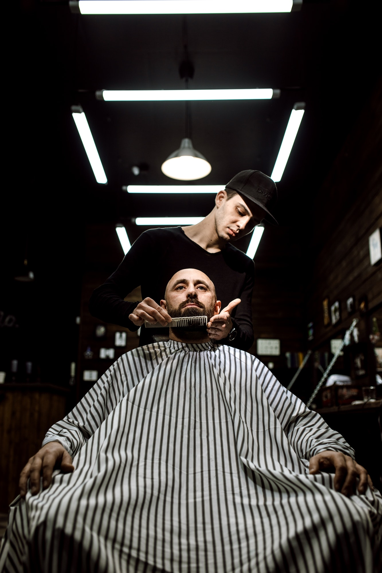 the-stylish-barbershop-the-fashion-barber-tidies-up-beard-of-brutal-man-sitting-in-the-armchair.jpg